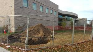 """Careful not to fall in this """"boring"""" hole by the Education and Arts building. Photo Credit/Rachael Pittman"""