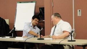 SGA Presidental Candidates Shail Bhagat and Stephen Salisbury shake hands at the SGA debate
