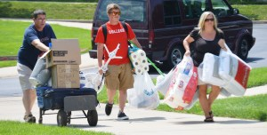 Does this not say all there is to say about college? A new student and his parents carry furniture and supplies into River Crossing Student Housing. PHOTO/C.A. PRINTUP