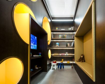 Sala infantil en Diseño de showroom de cocinas para Grupo Ramón García
