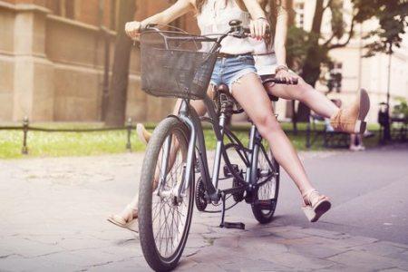 Part of boho girls legs during riding tandem bike