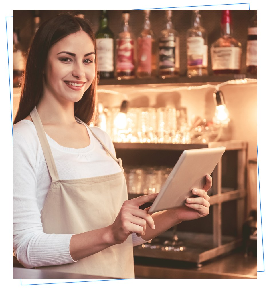 Restaurant Owner holding a mobile POS