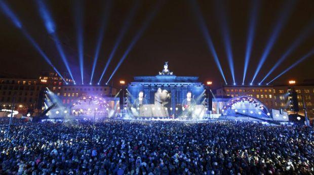 German actor Liefers speaks to people in front of the Brandenburg Gate in Berlin