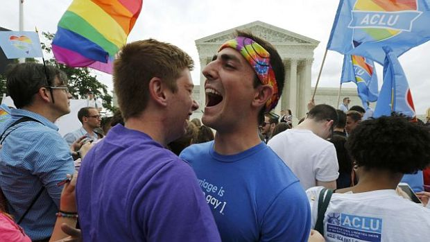 Gay rights supporters celebrate after the U.S. Supreme Court ruled that the U.S. Constitution provides same-sex couples the right to marry, outside the Supreme Court building in Washington, June 26, 2015. The court ruled 5-4 that the Constitution's guarantees of due process and equal protection under the law mean that states cannot ban same-sex marriages. With the ruling, gay marriage will become legal in all 50 states.  REUTERS/Jim Bourg