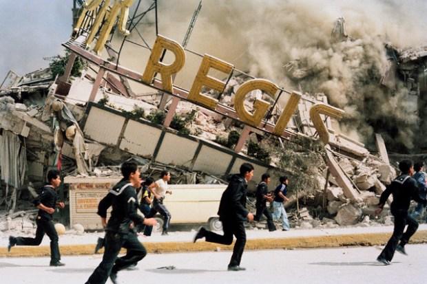 September 1985, Mexico City, Mexico --- A building collapses after the earthquake. --- Image by © Sergio Dorantes/Sygma/Corbis