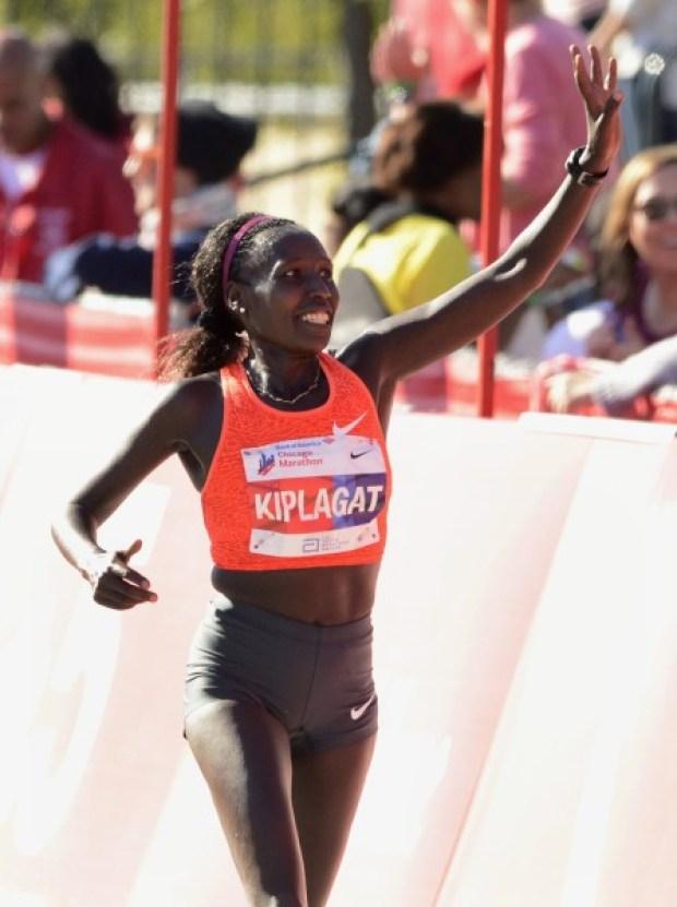 Florence Kiplagat, of Kenya, celebrates after winning the women's 2015 Bank of America Chicago Marathon, Sunday, Oct. 11, 2015, in Chicago. (AP Photo/Paul Beaty)