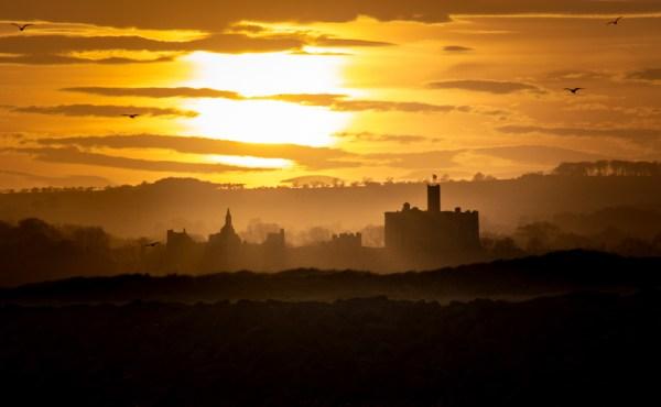 Sunset over Warkworth Castle