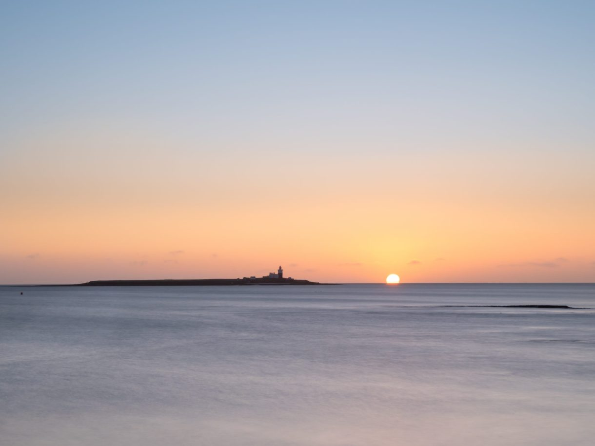 Coquet Island with the sun rising over the sea