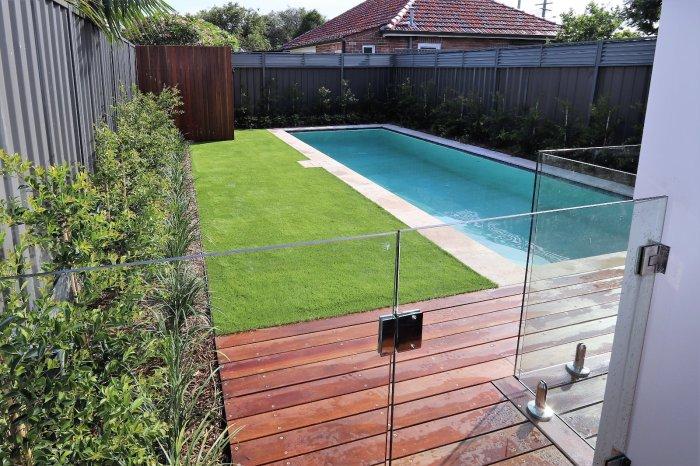 Garden pool surround by Ivory Gardens