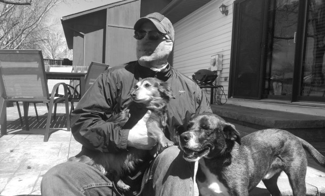 Picture of Martin C. Fredricks IV in coronavirus mask with his dogs.