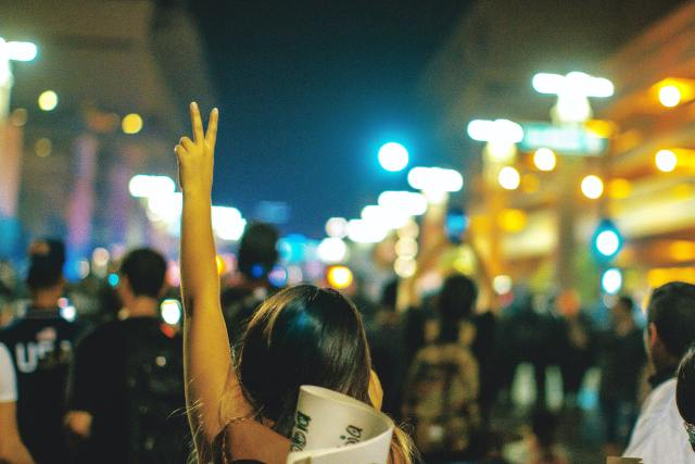 Photo of protester giving a peace sign.