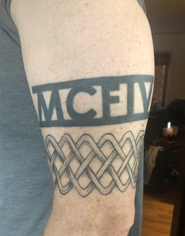 Image of tattoos on left arm
