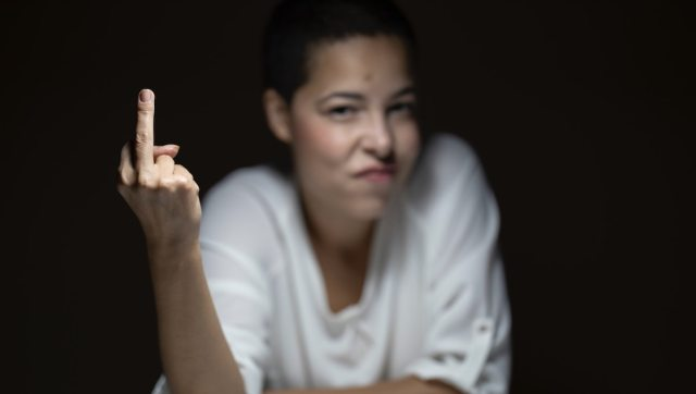 Image of a woman giving someone the middle finger