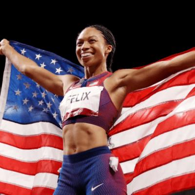 Photo of Allyson Felix holding American flag