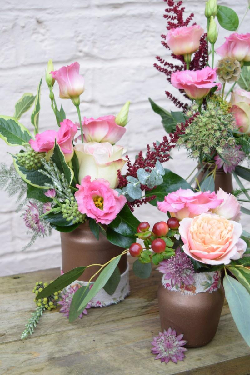 Rustic copper flower jars. Low level centrepiece.
