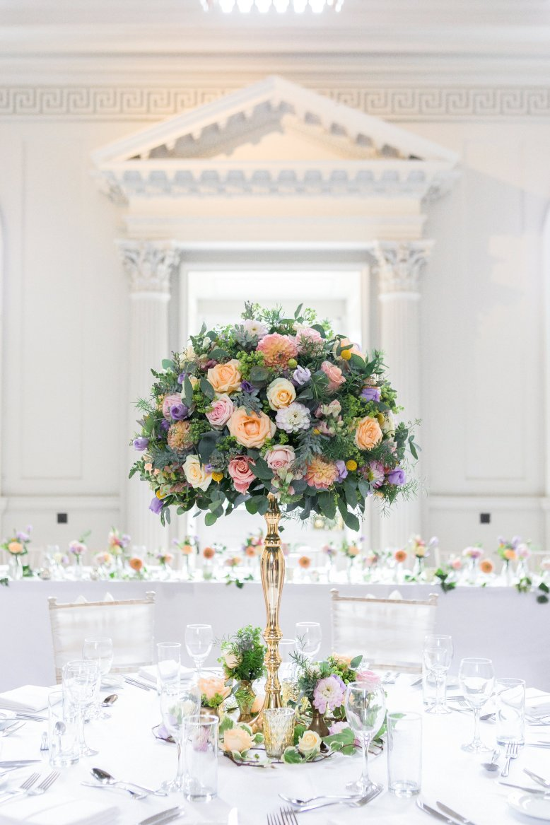 Tall wedding flowers centrepiece at Chicheley Hall