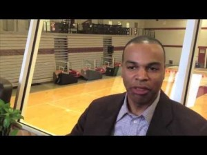 Tommy Amaker ponders how much he enjoys eating fruit salad in the suite at Lavietes Pavilion.