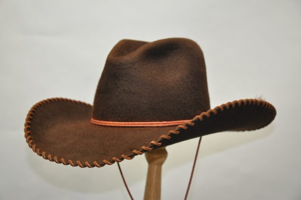 brow shag gus hat with light brown leather hatband and two horsehair tails. Stitched brim with light brown leather