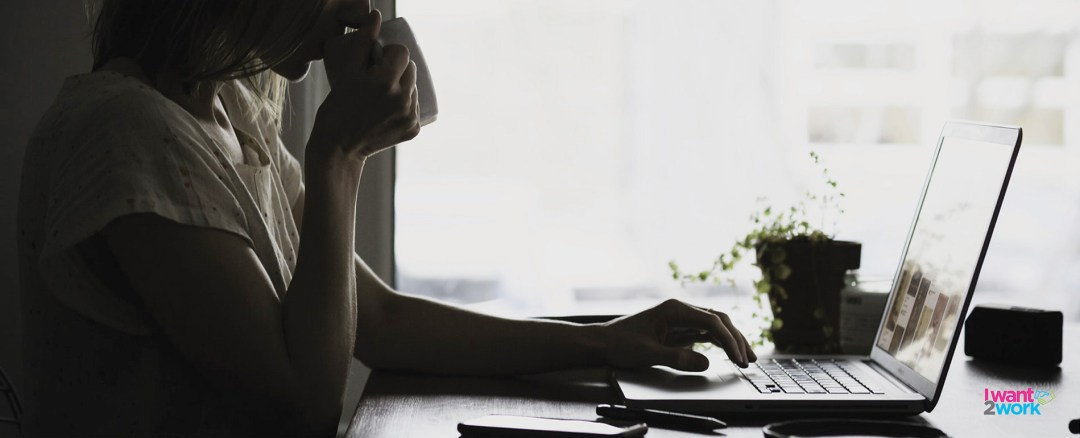 how to write an engaging cover letter girl sipping on coffee working on laptop