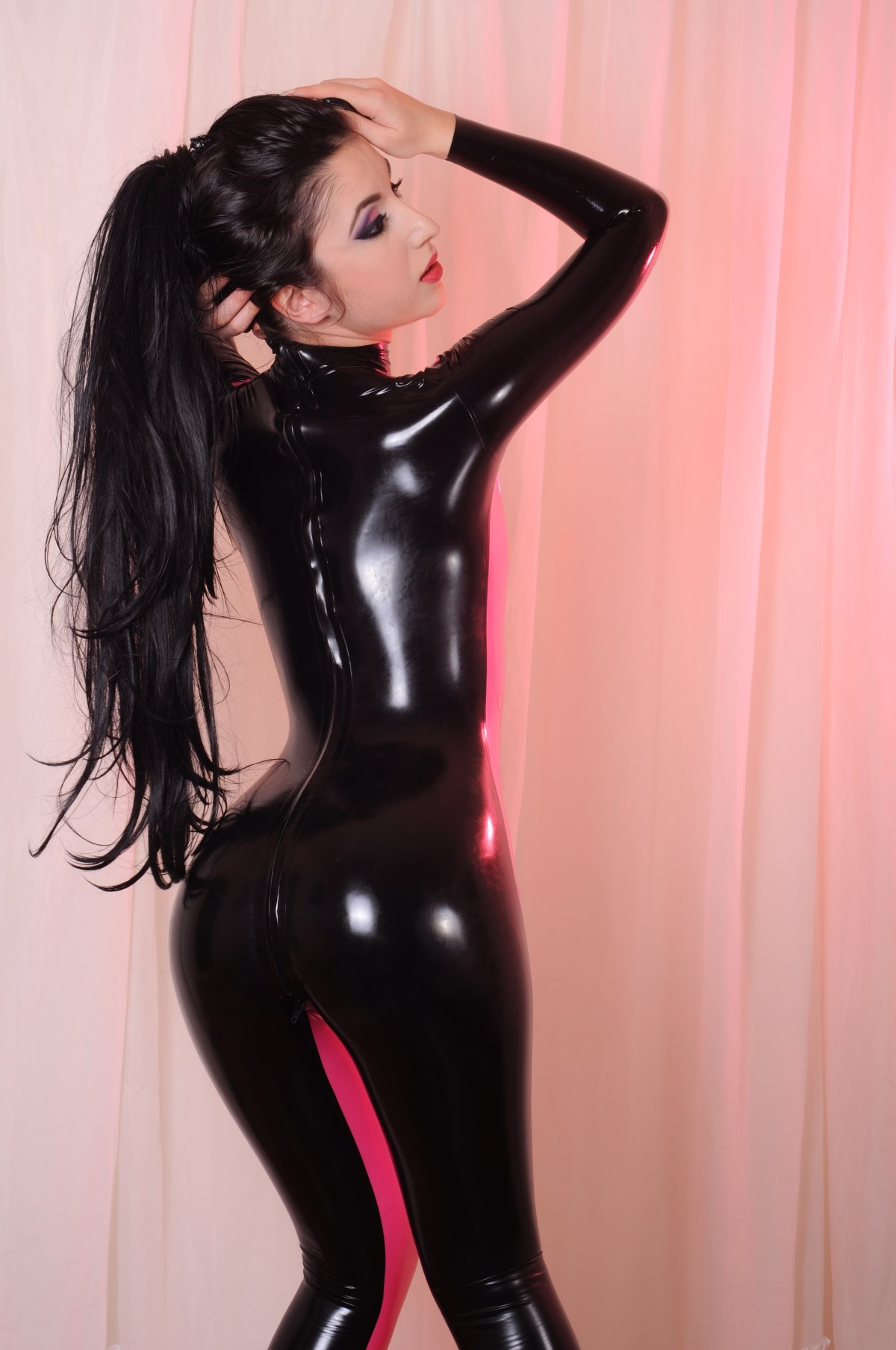 Back of a woman wearing sexy tight catsuit