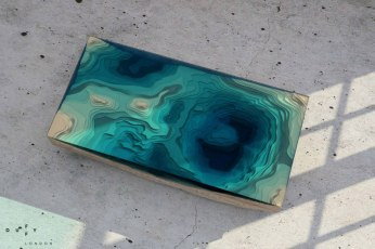 layered-glass-coffee-table-shows-depths-of-the-oceans-by-duffy-london-7