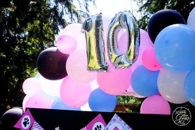 Ballooon arch with number 10 balloons.