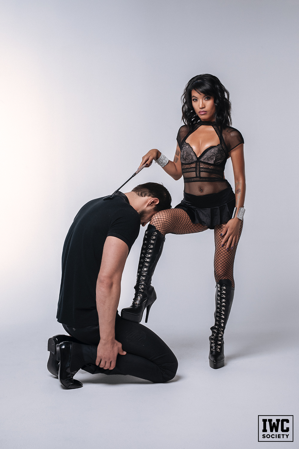 Asian goddess Asia Perez posing in black lingerie with black boots
