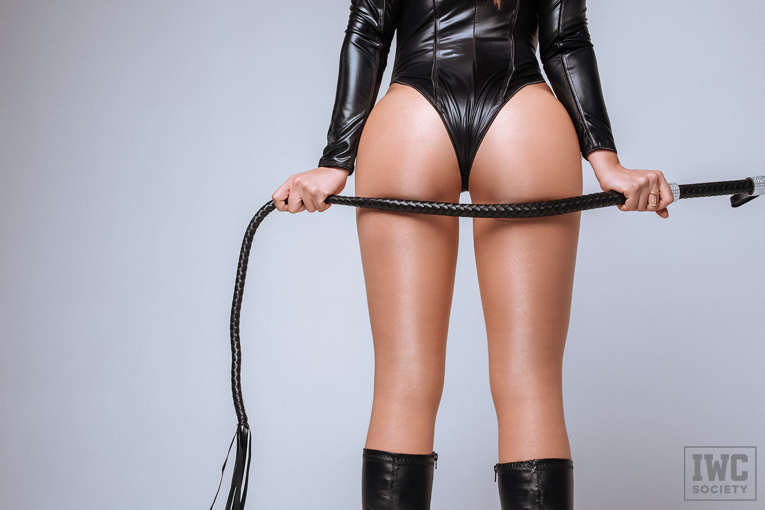 Ceara Lynch's butt with black whip