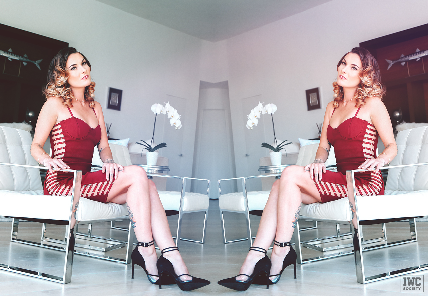 findomme goddess emerald wearing a red dress with mirror effect