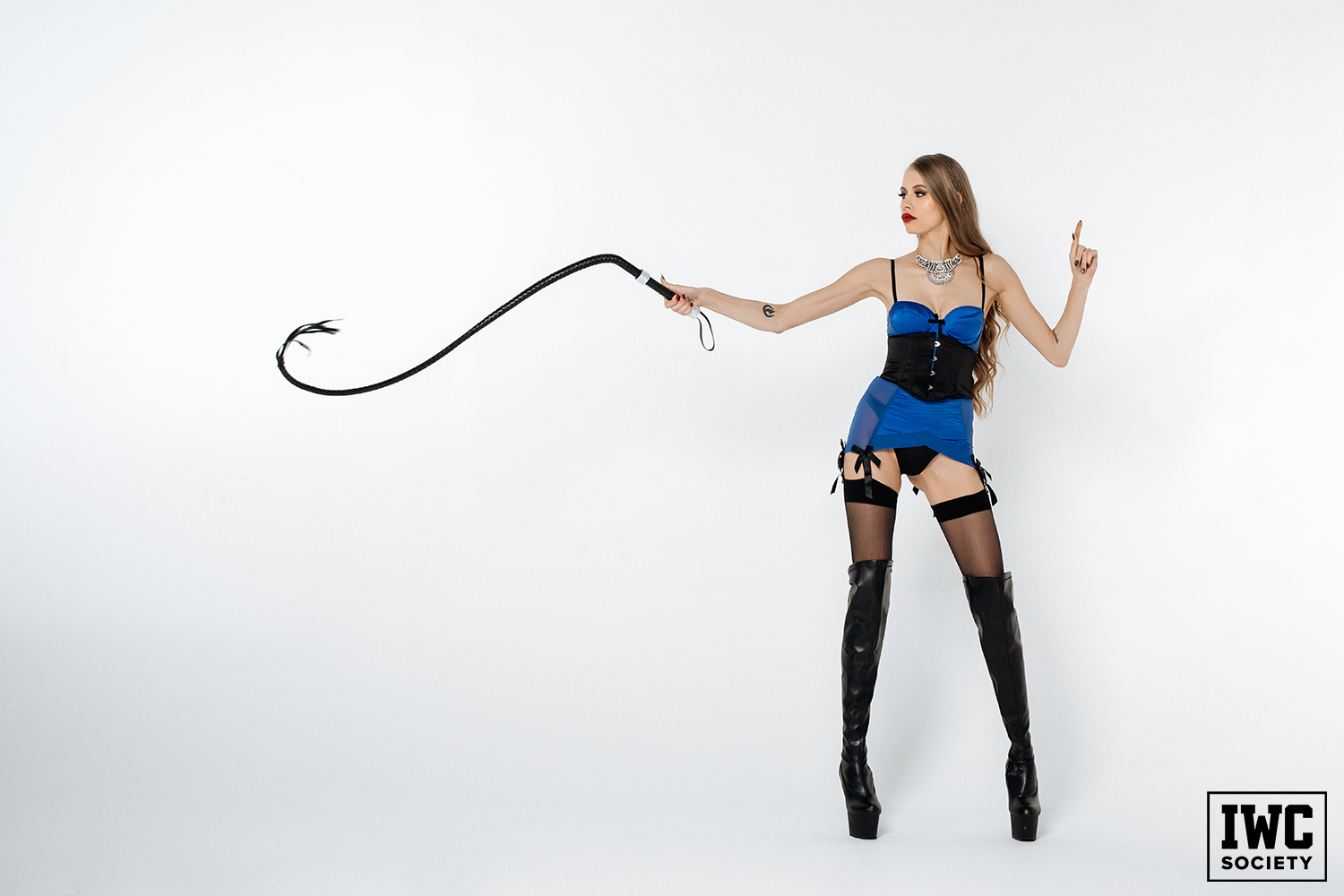 blonde dominatrix using her whip