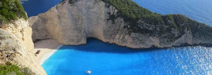 blue sea under clear blue sky