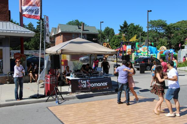 Couples dancing the heat away at the Salsa on St. Clair festival