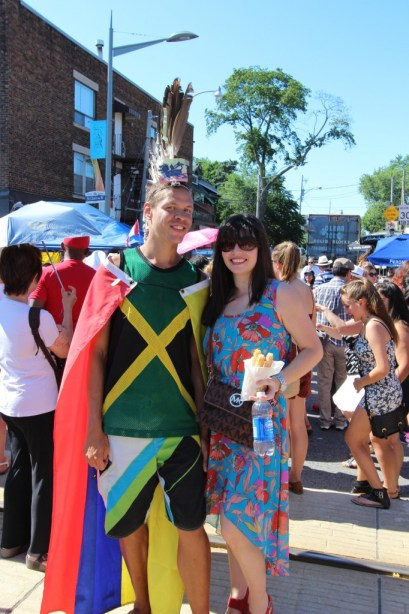 Guy with a mohak representing various Latin American countries at the Salsa on St. Clair festival