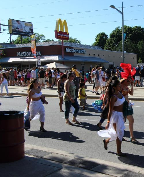 Latin girls walking to prepare for the Salsa on St. Clair parade