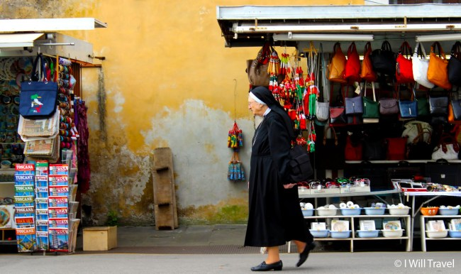 Nun walking the streets of Pisa, Italy