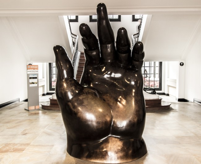 The Left Hand bronze sculpture located in the entrance of the Botero Museum