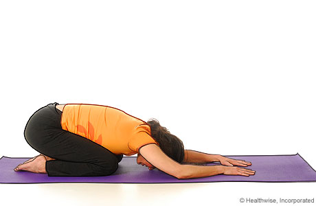 Picture of a woman in step four of yoga extended puppy pose