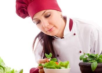 photo of succesfull female restaurant chef on white background