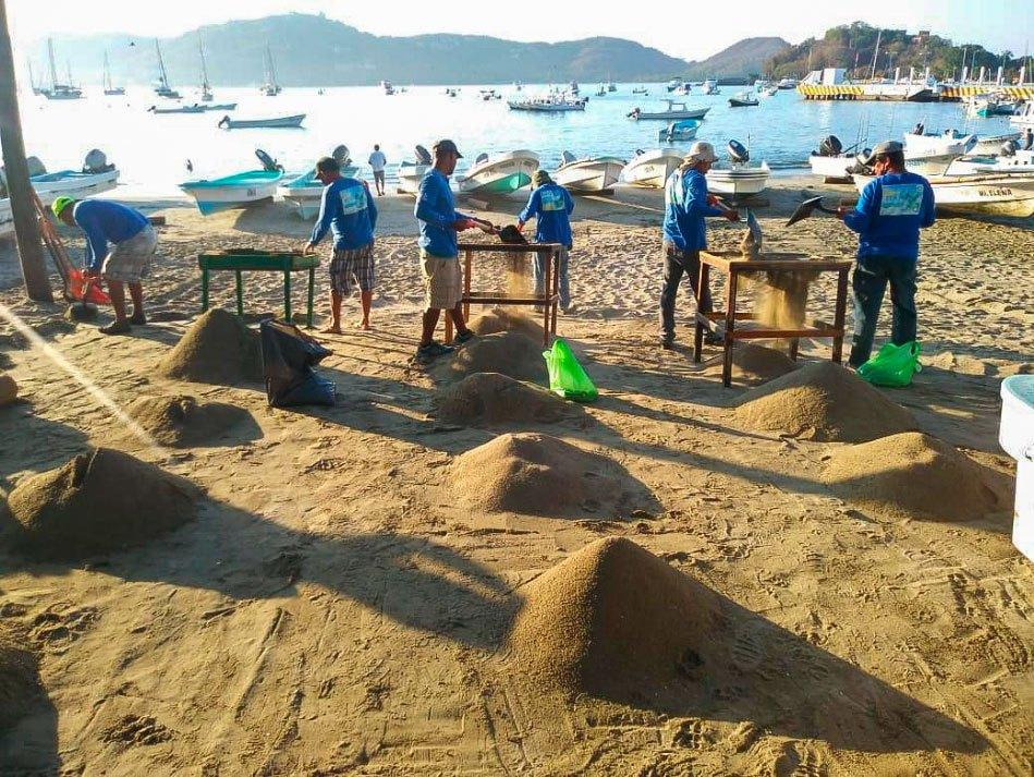 playa-principla-gobierno-limpieza-pescadores.jpg