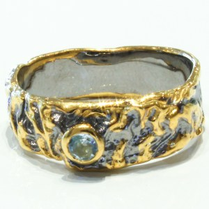 Blue Topaz Ring with Black and Gold details