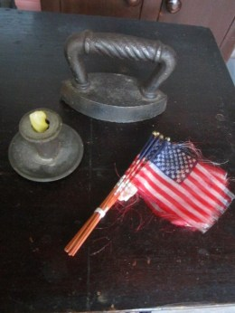 Silk flags to bedeck the doll's house for Flag Day, Memorial Day, 4th of July and Labor Day! Plus an iron to keep all the linens well pressed and a tin candle holder to keep the dark at bay.