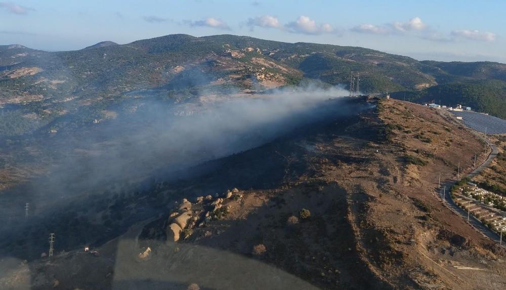 İzmir'de çöplükten çıkarak otluk alana sıçrayan yangın kontrol altında