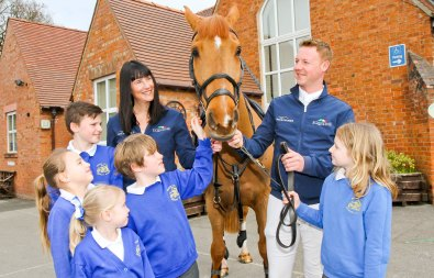 Children from Huxley Primary meeting Oscar the horse and the Bolesworth Team