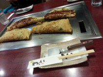 Okonomiyaki is like a Japanese omelette (omelette pancake?). Very tasty!