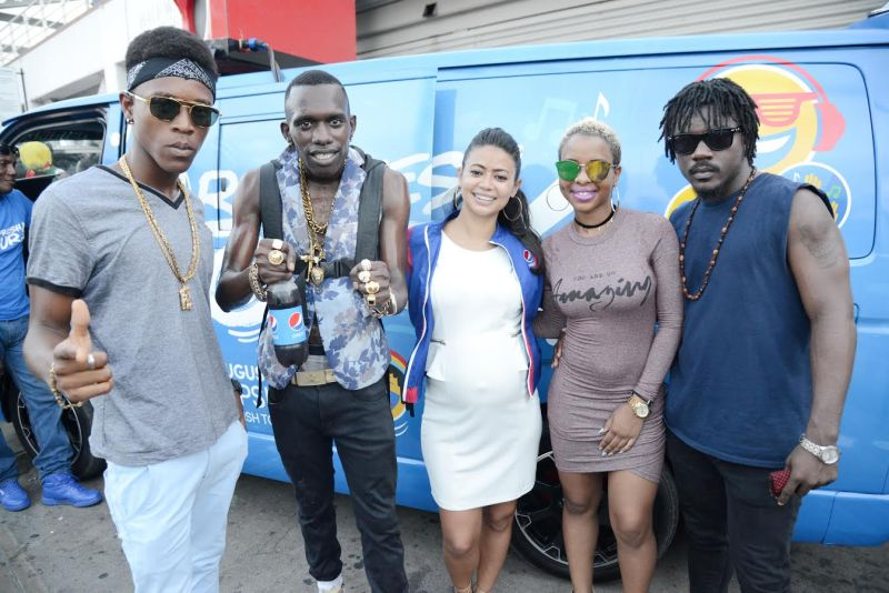 Elizabeth Swaby, (centre) Brand Manager, Carbonated Beverages, Pepsi Cola Jamaica is joined by Pepsi Refresh Tour artistes: (L-R) Eskabel, Tanto Blacks, Lia Caribe and Ishadyz; after they delivered a crowd pleasing set at the Pepsi Refresh Tour held outside the Half-Way-Tree Transport Centre last Friday