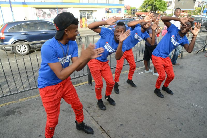 The male dancers from the Pepsi promo team hit their marks as they deliver a sharp routine at the Pepsi Refresh Tour held outside the Half-Way-Tree Transport Centre last Friday.