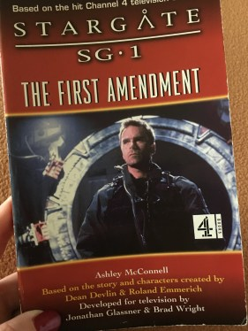 A photograph of Colonel Jack O'Neill on the front cover of the Stargate SG-1 companion novel The First Amendment by Ashley McConnell