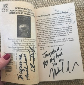 Michael Shanks and Christopher Judge autographs on the Stargate SG-1 novel The Price You Pay by Ashley McConnell