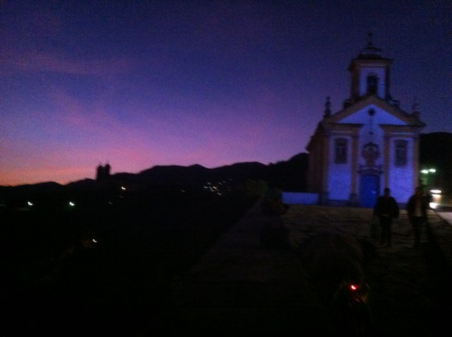 Colonial church glows next to the beautiful sky.