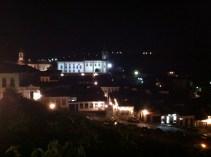 Looking over Praça Tiradentes lit up at night.